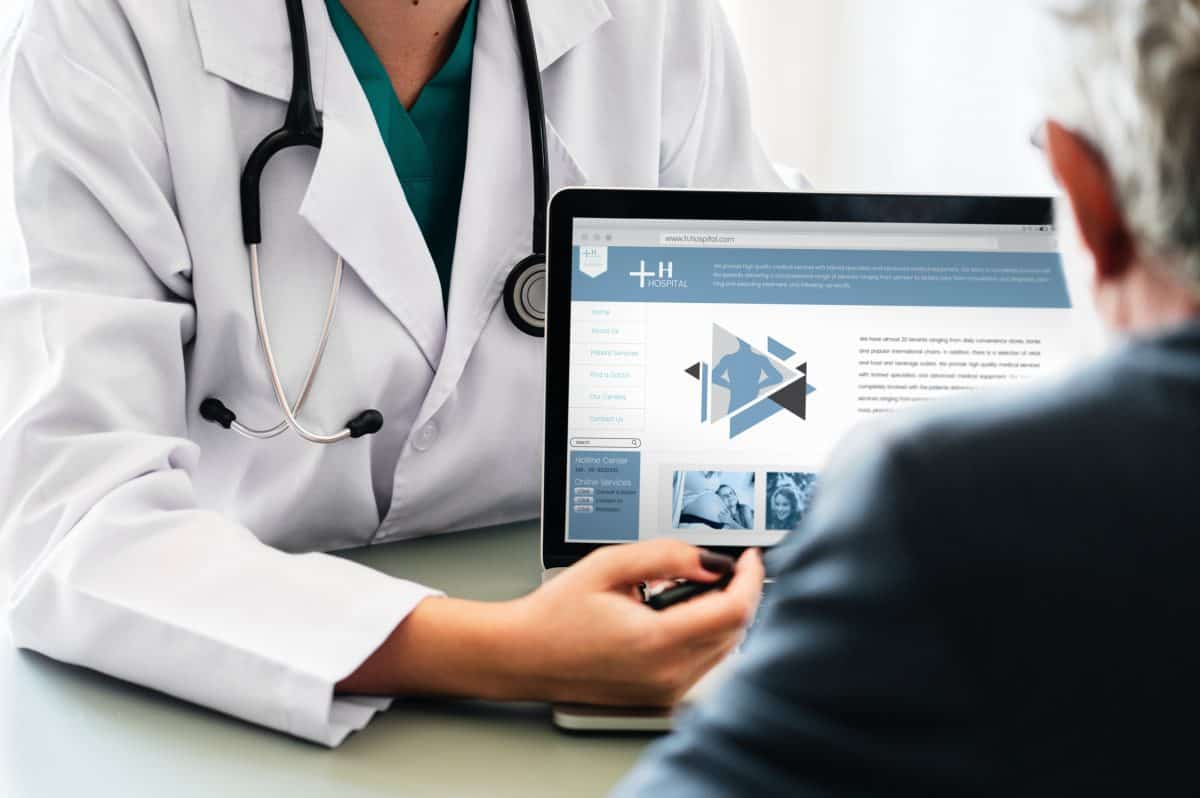 doctor showing image on a laptop to a patient