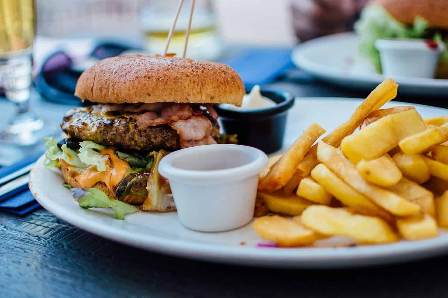 photo of a burger and fries