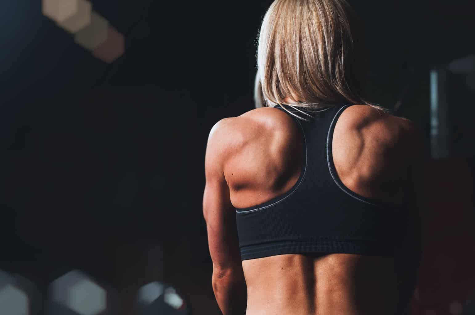 image of a muscular woman from the back