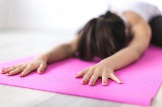 a woman on a yoga mat