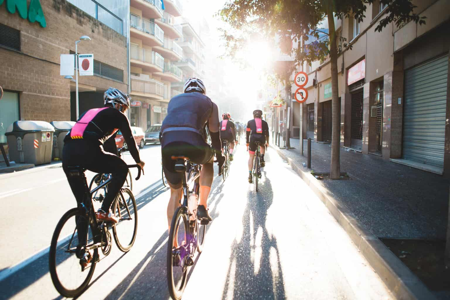 image of people cycling together